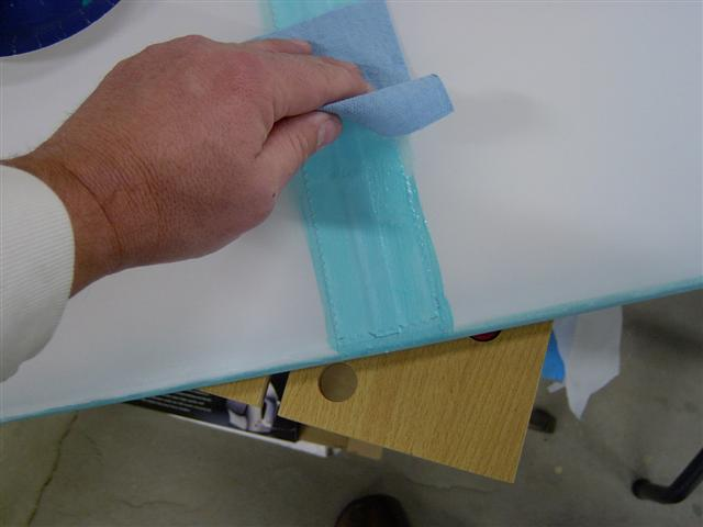 Wipe off excess glue for tapes.