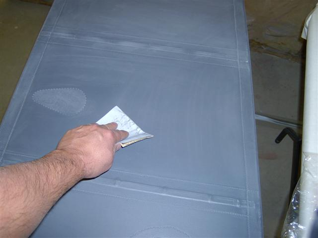 Light sanding with 320 grit open coat paper. Careful here!